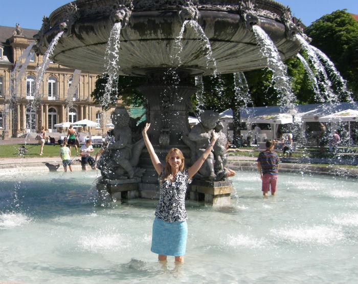 Having fun under the fountain in Stuttgart