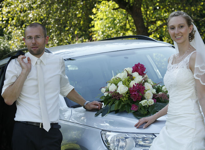 Decorated car and happy couple